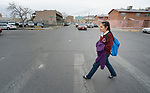 Yarely Arellano walks through El Paso, Texas, on her way to cross a bridge over the Rio Grande River into Mexico as she returns to her home in Juarez from studying at the Lydia Paterson Institute, a United Methodist sponsored high school in El Paso. Arrelano, 20, makes the journey every school day.
