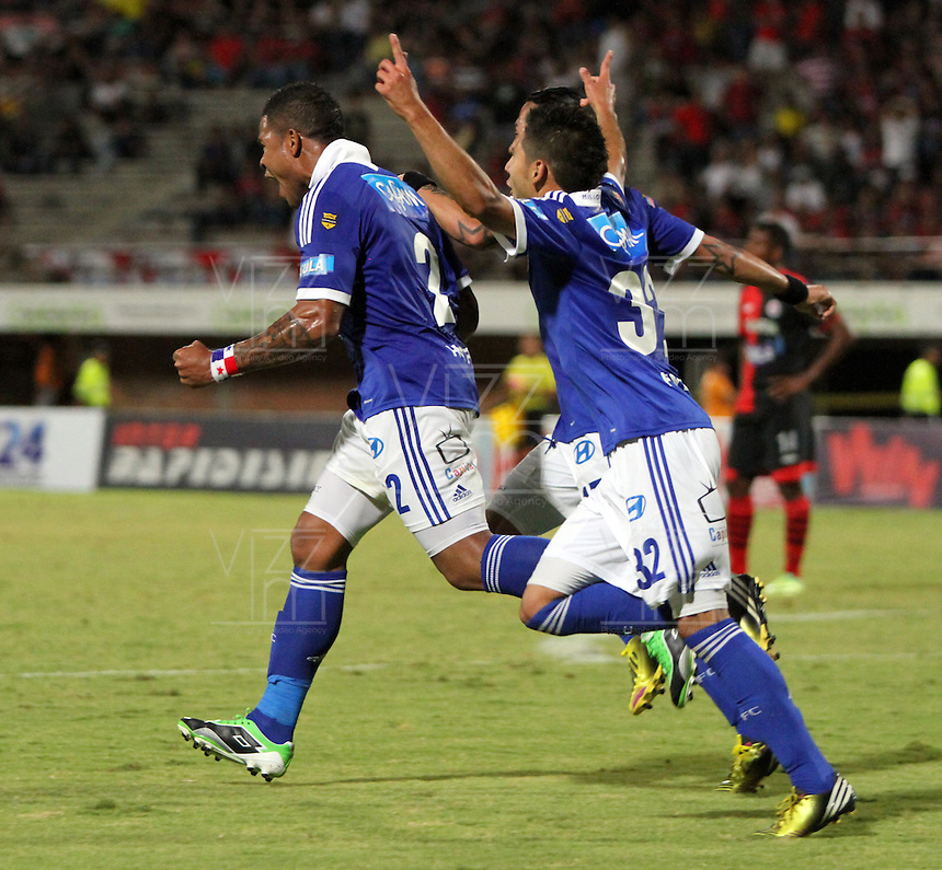 CUCUTA -COLOMBIA- 28-08-2013. Román Torres  de Millonarios celebra su gol  contra el Cucuta Deportivo  ,  partido correspondiente a la septima fecha de la  Liga Postobón segundo semestre disputado en el estadio Guiilermo Plazas Alcid     / Román Torres of Los Millonarios celebrates his goal against Deportivo Cucuta, game for the seventh time of the second half Postobón League match at the stadium Guiilermo Plazas Alcid. Photo: VizzorImage / Stringer