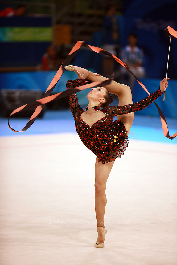 August 22, 2008; Beijing, China; Rhythmic gymnast Elizabeth Paisieva of Bulgaria turns with ribbon on way placing 19th in qualifying round at 2008 Beijing Olympics. Copyright 2008 Tom Theobald