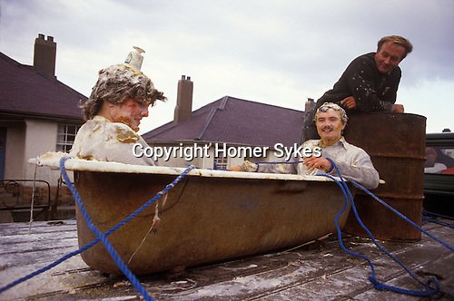 Blackening the bride and groom. a pre-wedding folklore Scottish marriage ritual Mallaig Scotland Uk.<br />