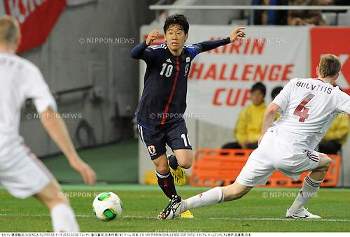 Shinji Kagawa (JPN), Nauris Bulvitis (LAT),.FEBRUARY 6, 2013 - Football / Soccer :.Kirin Challenge Cup 2013 match between Japan 3-0 Latvia at Home's Stadium Kobe in Hyogo, Japan. (Photo by Takamoto Tokuhara/AFLO)