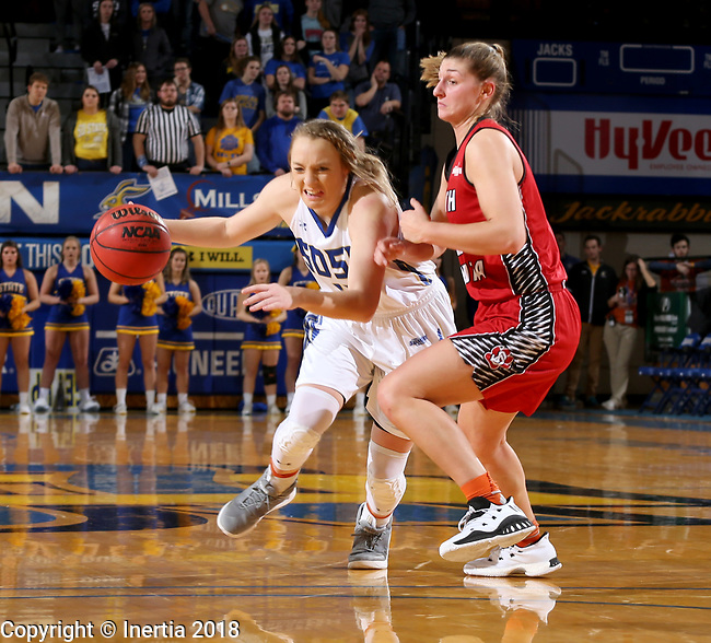 BROOKINGS, SD - JANUARY 25: Madison Guebert #11 from South Dakota State University tries to drive against Jaycee Bradley #12 from the University of South Dakota during their game Thursday night at Frost Arena in Brookings. (Photo by Dave Eggen/Inertia)