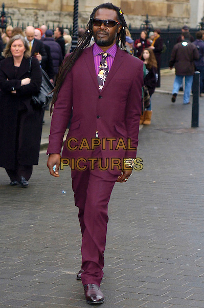 LEVI ROOTS .at The Woman's Own Children Of Courage Award, Westminster Abbey, London, England, UK, .December 10th 2009..full length purple maroon burgundy suit pink shirt tie sunglasses bracelet .CAP/DYL.©Dylan/Capital Pictures.
