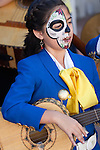 Child mariachi musicians with calavera face paint for Day of the Dead celebration at the Bowers Museum in Santa Ana, CA