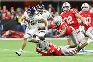 Indianapolis, IN - December 1, 2018: Northwestern Wildcats running back Isaiah Bowser (25) breaks a tackle during the Big Ten championship game between Northwestern  and Ohio State at Lucas Oil Stadium in Indianapolis, IN.   (Photo by Elliott Brown/Media Images International)