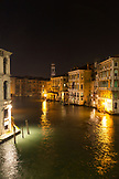 ITALY, Venice. View of the Grand Canal and homes from the Rialto Bridge at night.