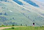 A jogger on Waterworks hill heads back toward town. Mount Sentinel and the M are visible across the Hellgate Canyon