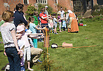 Children archery lesson during Tudor history day at Layer Marney, Essex, England