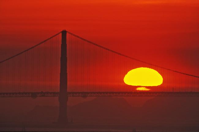 Sunset behind Golden Gate bridge