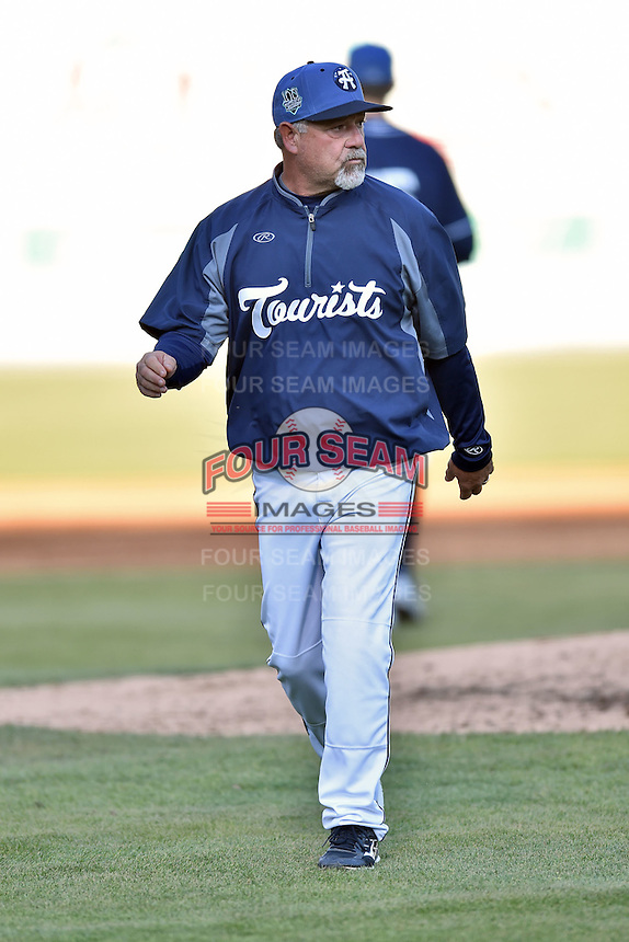 Asheville Tourists pitching coach Mark Brewer (8) during a game against the Lexington Legends on May 2, 2015 in Asheville, North Carolina. The Legends defeated the Tourists 12-3. (Tony Farlow/Four Seam Images)