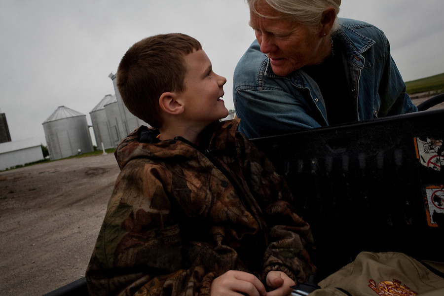 Wellsville, Kansas, May 28, 2011 - Fourth generation family farmer Robin Dunn talks with nephew Anthony Dunn at her farm, Dunn's Landing. Dunn, who has no children, says that Anthony is a born farmer and has taken him under her wing to teach him about the farm. ..Dunn bought her great grandparents homestead from her father in 1993, and today grows soybeans, corn, sorghum and hay, and maintains a small herd of Black Angus cattle and eight horses which she uses to for wagon and stage coach rides.  According to the most recent Department of Agriculture data, there are more than 306,000 farms run primarily by women in 2007, representing about 14 percent out of the 3.3 million American farms.  That's up from 237,819 or 11 percent in 2002, and a big increase from the 1980s when about five percent of U.S. farms were operated by women.Dunn has branched out from her farming business, using her century-old dairy barn to host 25 to 30 weddings and other events a year. She also attracts tourists for farm tours and carriage rides, and holds sessions with school children to teach them about faming.