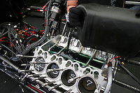 Apr. 26, 2013; Baytown, TX, USA: Detailed view as oil is put in the engine block on the car of NHRA funny car driver Cruz Pedregon during qualifying for the Spring Nationals at Royal Purple Raceway. Mandatory Credit: Mark J. Rebilas-