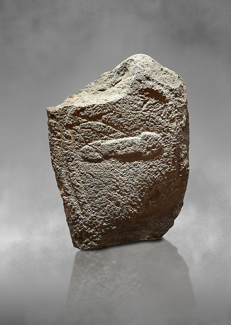 Late European Neolithic prehistoric Menhir standing stone with carvings on its face side. The representation of a stylalised male figure with the remains of a  carving of a dagger running horizontally across the menhir. Excavated from Cuccu de Lai,  Samugheo. Menhir Museum, Museo della Statuaria Prehistorica in Sardegna, Museum of Prehoistoric Sardinian Statues, Palazzo Aymerich, Laconi, Sardinia, Italy
