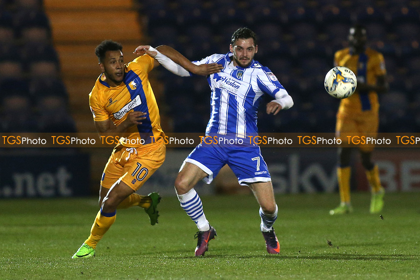 Drey Wright of Colchester United and Matt Green of Mansfield Town during Colchester United vs Mansfield Town, Sky Bet EFL League 2 Football at the Weston Homes Community Stadium on 14th March 2017