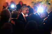 United States President Barack Obama arrives at a dinner on the occasion of the U.S.-Africa Leaders Summit on the South Lawn of the White House August 5, 2014 in Washington, DC. Obama is promoting business relationships between the United States and African countries during the three-day U.S.-Africa Leaders Summit, where 49 heads of state are meeting in Washington.  <br /> Credit: Chip Somodevilla / Pool via CNP