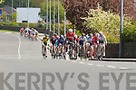 The cyclists pass through Castleisland during he Johnny Drum classic in Currow on Sunday