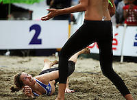 Germany's Okka Rau hits the sand during the 2009 McEntee Hire NZ Beach Volleyball Tour - Women's final at Oriental Parade, Wellington, New Zealand on Sunday, 11 January 2009. Photo: Dave Lintott / lintottphoto.co.nz.