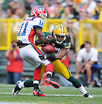 Green Bay Packers safety Morgan Burnett intercepts a pass intended for  Buffalo Bills' Roscoe Parrish in the fourth quarter during the home opener at Lambeau Field in Green Bay, Wis., on Sunday, Sept. 19, 2010.