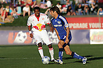 23 April 2009:  Claudio Lopez (7) of the Wizards moves the ball past Danleigh Borman (11) of the Red Bulls.  The MLS Kansas City Wizards defeated the visiting New York Red Bulls 1-0 at Community America Ballpark in Kansas City, Kansas.