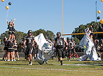 Palos Verdes, CA 10/24/14 - Steven Smith (Peninsula #3) and Jacob Rathbun (Peninsula #51) lead the team onto the field.in action during the Redondo Union - Palos Verdes Peninsula CIF Varsity football game at Peninsula High School.