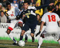 London Woodberry #22 of the University of Maryland holds onto Justin Meram #9 of the University of Michigan during an NCAA quarter-final match at Ludwig Field, University of Maryland, College Park, Maryland on December 4 2010.Michigan won 3-2 AET.