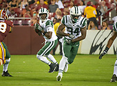 New York Jets quarterback Teddy Bridgewater (5) looks for a receiver after faking a hand-off to New York Jets running back George Atkinson (34) in fourth quarter action against the Washington Redskins at FedEx Field in Landover, Maryland on Thursday, August 16, 2018.  The Redskins won the game 15 - 13.<br /> Credit: Ron Sachs / CNP<br /> (RESTRICTION: NO New York or New Jersey Newspapers or newspapers within a 75 mile radius of New York City)