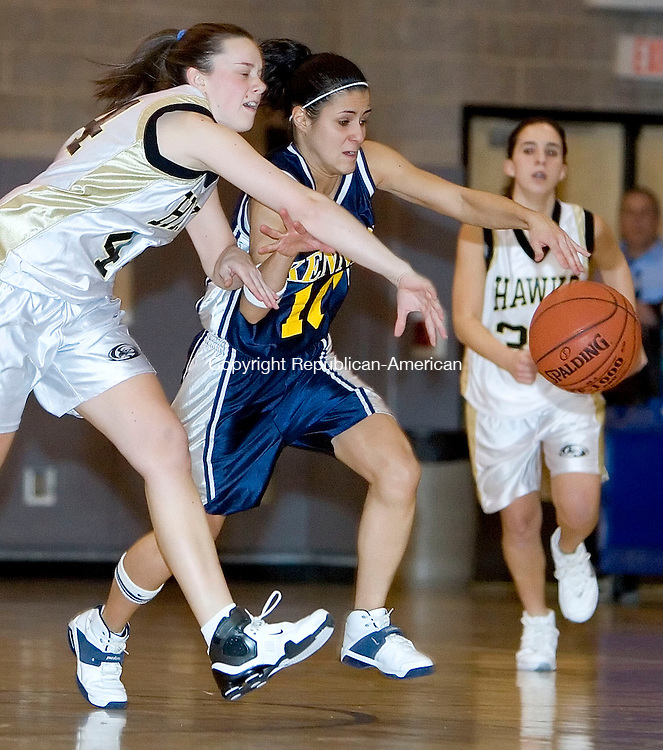 BEACON FALLS, CT- 08 DEC 06- 120806JT11- <br /> Woodland's Steph Kooharian and Kennedy's Marjorie Oliveira reach for a loose ball during Friday's game at Woodland. <br /> Josalee Thrift Republican-American