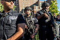 New York, USA 12 June 2016 -  In the wake of the mass shooting that left at least 50 dead and more than 50 others wounded at Pulse ;  a gay nightclub in Orlando, Florida, NYPD has stepped up security at the City's various Lesbian and Gay sites. Monday evening the Counter Terrorism Bureau, armed with assault weapons and aided by bomb sniffing dogs oversaw security during a igil at the Stonewall Inn. ©Stacy Walsh Rosenstock/Alamy Live News