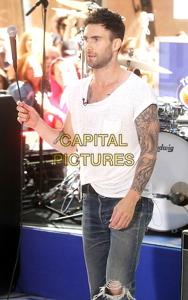 """ADAM LEVINE of MAROON 5.Maroon 5 Perform On NBC's """"Today"""" at Rockefeller Center,  New York, NY, USA, 2nd July 2010..half length music concert gig live on stage jeans microphone ripped hole  white cream t-shirt tattoos .CAP/ADM/AC.©Alex Cole/AdMedia/Capital Pictures."""