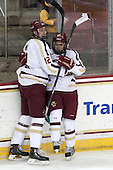 Johnny Gaudreau (BC - 13) and Kevin Hayes (BC - 12) celebrate Gaudreau's opening score. - The Boston College Eagles defeated the visiting University of New Hampshire Wildcats 6-2 on Friday, December 6, 2013, at Kelley Rink in Conte Forum in Chestnut Hill, Massachusetts.