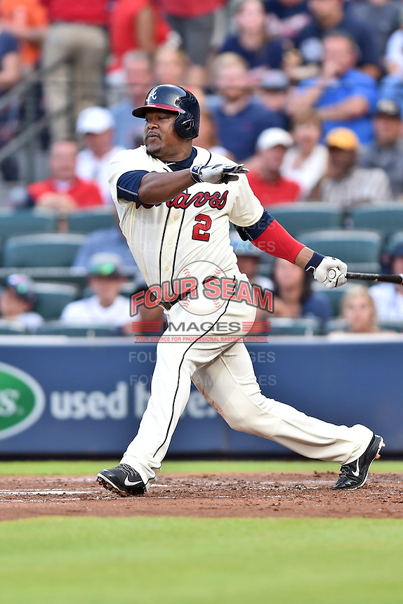 Atlanta Braves third baseman Juan Uribe (2) swings at a pitch during a game against the Chicago Cubs on July 18, 2015 in Atlanta, Georgia. The Cubs defeated the Braves 4-0. (Tony Farlow/Four Seam Images)