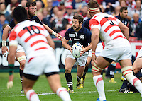 Greig Laidlaw of Scotland in possession. Rugby World Cup Pool B match between Scotland and Japan on September 23, 2015 at Kingsholm Stadium in Gloucester, England. Photo by: Patrick Khachfe / Onside Images