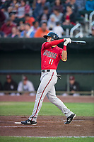 Billings Mustangs first baseman Leonardo Seminati (11) follows through on his swing during a Pioneer League game against the Idaho Falls Chukars at Melaleuca Field on August 22, 2018 in Idaho Falls, Idaho. The Idaho Falls Chukars defeated the Billings Mustangs by a score of 5-3. (Zachary Lucy/Four Seam Images)