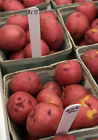 Red organic potatoes in baskets for sale at a farmers market
