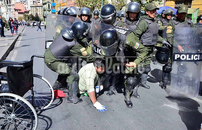 Handicapped people demanding a minimum government wage clash with police in dowtown La Paz, Bolivia