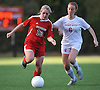 St. John the Baptist No. 13 Skylar Prendergast, left, gets pressured by Sacred Heart No. 6 Kristen McArdle during a CHSAA varsity girls' soccer game at Sacred Heart Academy on Monday, October 5, 2015. Sacred Heart won by a score of 3-1.<br /> <br /> James Escher