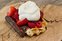 Chocolate dipped waffle with berries and whipped cream