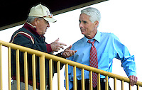 TALLAHASSEE, FL. 4/9/07-Florida State Football Coach Bobby Bowden, left, talks with Gov. Charlie Crist, during his visit to spring football practice, Monday in Tallahassee. Crist said he was invited by Bowden to visit a practice. Crist played quarterback at St. Petersburg High School and was a walk-on with the Wake Forest squad before transferring to Florida State where he did not play football but did complete his undergraduate degree. COLIN HACKLEY PHOTO