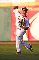 Kyle Conley (35) of the Springfield Cardinals throws a ball back to the infield during a game against the Arkansas Travelers at Hammons Field on June 12, 2012 in Springfield, Missouri. (David Welker/Four Seam Images)