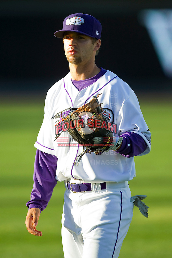 Joey DeMichele (18) of the Winston-Salem Dash warms up in the outfield prior to the game against the Carolina Mudcats at BB&T Ballpark on April 13, 2013 in Winston-Salem, North Carolina.  The Dash defeated the Mudcats 4-1.  (Brian Westerholt/Four Seam Images)
