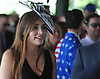 A festively dressed woman makes her way into Belmont Park from its connecting LIRR train station during the 150th running of the Belmont Stakes on Saturday, June 9, 2018