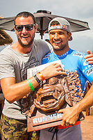 KERAMAS, Bali/Indonesia (Thursday, June 27, 2013) Andy King (AUS) coach and Michel Bourez (PYF) &ndash; Joel Parkinson (AUS), 32, has won the inaugural Oakley Pro Bali over Michel Bourez (PYF), 27, via an impressive come-from-behind effort in four-to-six foot (2 metre) waves at the iconic Balinese righthander of Keramas.<br /> <br /> Stop No. 5 of 10 on the ASP World Championship Tour (WCT), the Oakley Pro Bali hosted a historic high-performance showdown including perfect heats and next level progression from the world&rsquo;s best surfers, culminating with Parkinson&rsquo;s hard-fought victory over Bourez in the Final.<br /> <br /> Parkinson was quick to adapt to the changing conditions on the final day of action, besting fellow countrymen Taj Burrow (AUS), 35, and Josh Kerr (AUS), 29, en route to the Final. The natural-footer got off to a slow start on his road to victory, but an impressive series of fully-committed forehand combinations on a steep righthand wall would see the reigning ASP World Champion surpass the Tahitian in the final minutes for the win.<br /> <br /> The Oakley Pro Bali marks Parkinson&rsquo;s first ASP WCT victory of the season, vaulting the stylish Australian to No. 3 on the rankings and within striking distance of the 2013 ASP World Title.<br /> <br /> Michel Bourez attacked the flawless righthanders of Keramas with incredible power, besting two-time ASP World Champion Mick Fanning (AUS), 32, and dangerous rookie Nat Young (USA), 22, on his way to the Final. Bourez would hold the lead throughout the majority of the Final, but was unable to block Parkinson&rsquo;s late-heat charge, taking both a runner-up finish and the best ASP WCT result of his career.<br /> <br /> Nat Young (USA), 22, ASP WCT Rookie, continued to impress in Bali, threading excellent barrels and igniting deadly backhand turns at Keramas en route to a Semifinals finish. The Santa Cruz native was on the way to his second Final appearance of the season, but was stopped short by a rampaging Michel Bourez, finishing equal 3rd overall.<br /> Josh Kerr (AUS), 29,