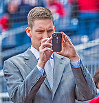 1 April 2013: Washington Nationals Senior Director of Baseball Media Relations John Dever takes a batting practice photo prior to the Opening Day Game against the Miami Marlins at Nationals Park in Washington, DC. The Nationals shut out the Marlins 2-0 to launch the 2013 season. Mandatory Credit: Ed Wolfstein Photo *** RAW (NEF) Image File Available ***