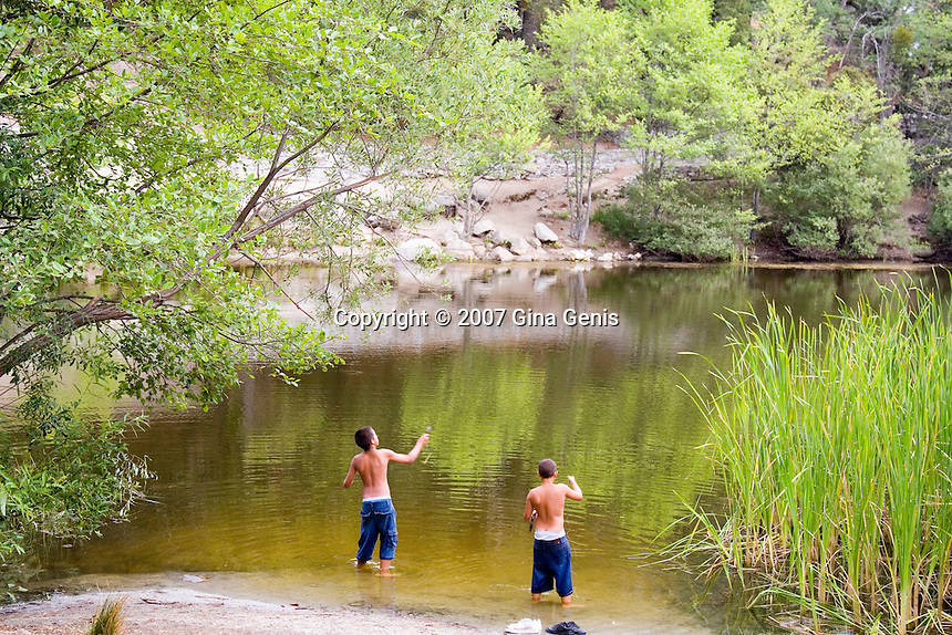 Boys fishing at Lake Fulmor in the mountains of Southern California