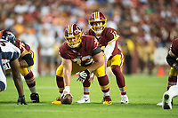 Landover, MD - August 24, 2018: Washington Redskins quarterback Alex Smith (11) takes the snap from Washington Redskins center Chase Roullier (73) during preseason game between the Denver Broncos and Washington Redskins at FedEx Field in Landover, MD. The Broncos defeat the Redskins 29-17. (Photo by Phillip Peters/Media Images International)