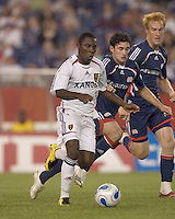 Freddy Adu (Real Salt Lake, white) takes on two defenders, Jay Heaps (Revolution, blue) and Jeff Larentowicz (Revolution, blue). New England Revolution played Real Salt Lake to a 0-0 tie, at Gillette Stadium on June 2, 2007.