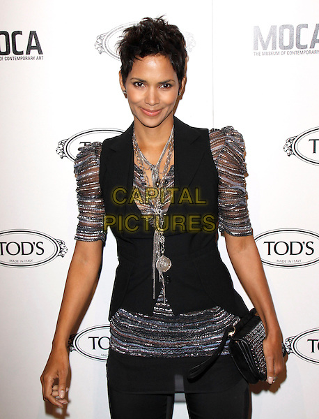 HALLE BERRY.The Diego Della Valle Cocktail Celebration Honoring Tod's Beverly Hills Boutique And MOCA's New Director Jerry Deitch at Tod's Boutique in Beverly Hills, California, USA..April 15th, 2010        .half length silver grey gray sheer puff sleeve top waistcoat black vest clutch bag necklace sheer striped shiny .CAP/RKE/DVS.©DVS/RockinExposures/Capital Pictures.