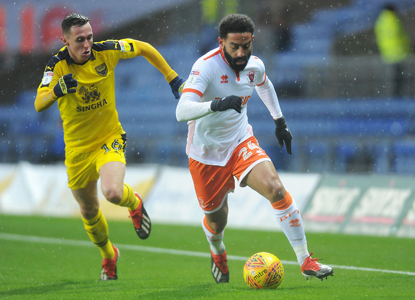 Blackpool's Liam Feeney under pressure from Oxford United's Gavin Whyte<br /> <br /> Photographer Kevin Barnes/CameraSport<br /> <br /> The EFL Sky Bet League One - Oxford United v Blackpool - Saturday 15th December 2018 - Kassam Stadium - Oxford<br /> <br /> World Copyright © 2018 CameraSport. All rights reserved. 43 Linden Ave. Countesthorpe. Leicester. England. LE8 5PG - Tel: +44 (0) 116 277 4147 - admin@camerasport.com - www.camerasport.com
