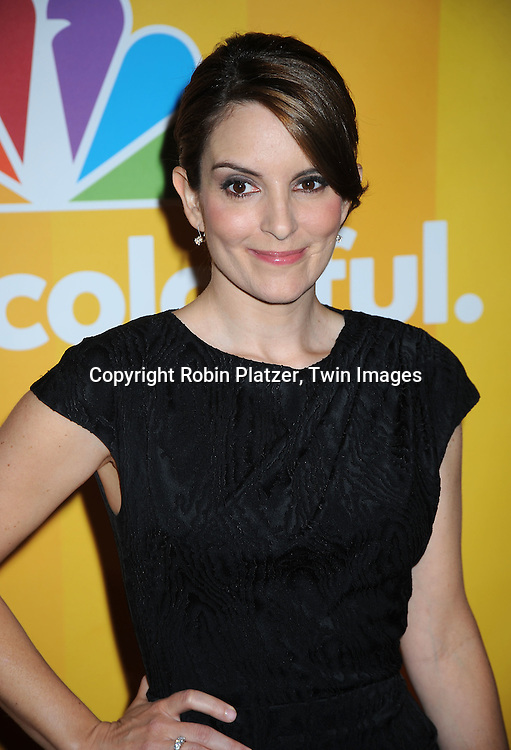 Tina Fey in Tadashi dress posing for photographers at the NBC Universal's Upfront presentation of the 2010-2011 Season on May 17, 2010 at The New York Hilton Hotel in New York City.