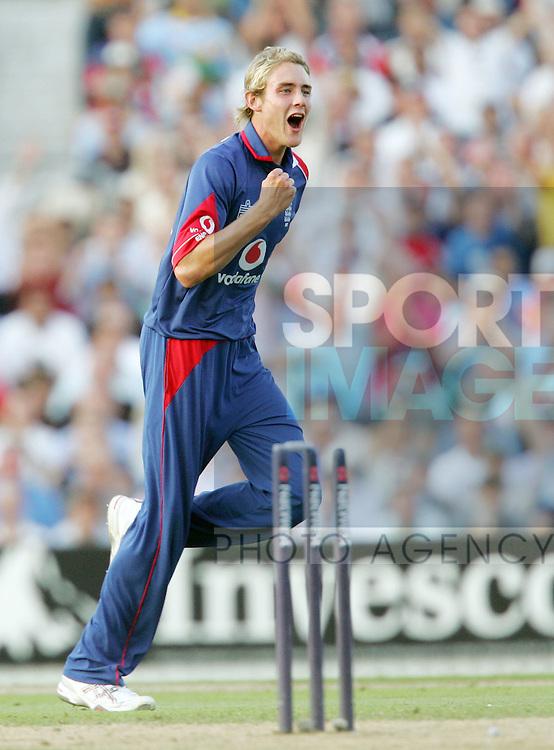 England's Staurt Broad celebrates clean bowling Mahendra Dhoni. .Pic: SPORTIMAGE/David Klein